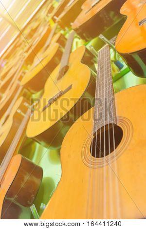Guitar,Guitar Wood close up And orange light