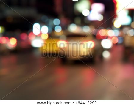 defocused colorful car lights and street lamp bokeh abstract background, blurred city life at night of Chinatown, Thailand