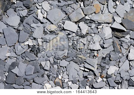Broken slate and shards on the ground