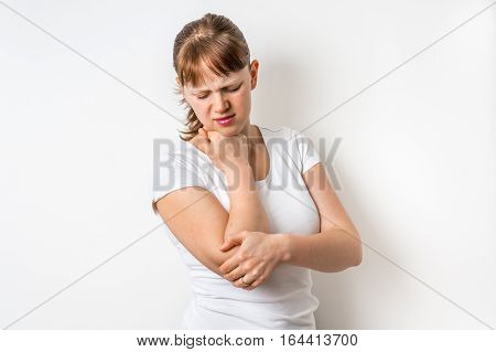 Woman With Elbow Pain Is Holding Her Aching Arm