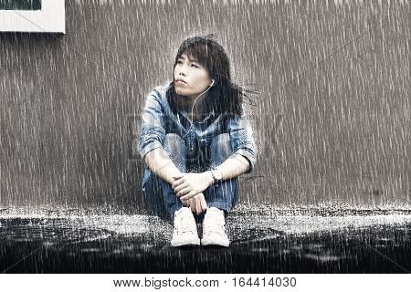 rainy season Woman in jeans in rainy day.