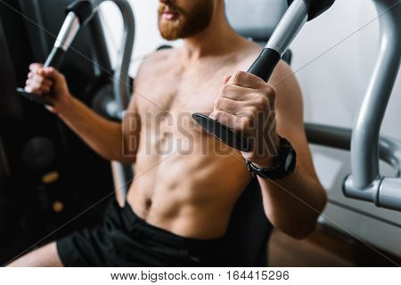 Focus on strong hands holding part of power training apparatus
