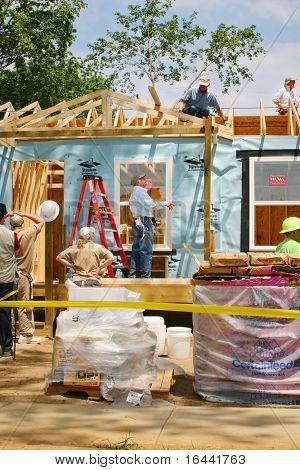 Former President Jimmy Carter, helping build houses for Habitat for Humanity