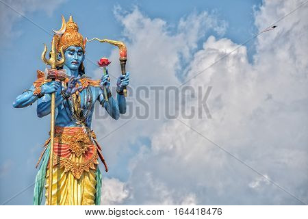 Shiva Statue In The Blue Light Sky Background