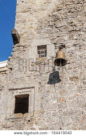 Crimea near the town of Old Crimea . Monastery of the Armenian Apostolic Church of Surb Khach ( Holy Cross Convent ) founded in the fifteenth century . The alarm bell on the wall of the refectory .