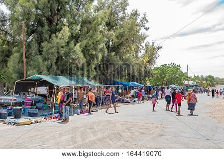 JACOBSDAL SOUTH AFRICA - DECEMBER 24 2016: Unidentified shoppers at an informal street market in Jacobsdal a small town in the Free State Province.