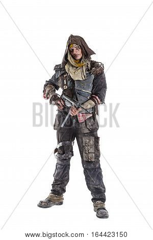 Nuclear post apocalypse life after doomsday concept. Grimy survivor with homemade weapons. Studio closeup portrait on white background