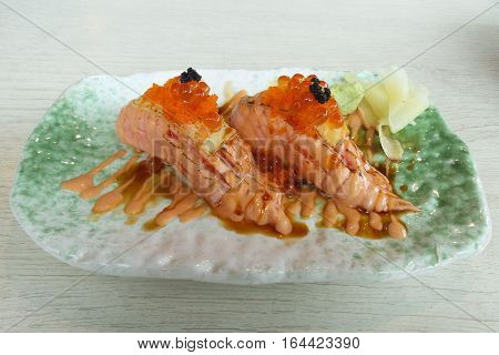 The picture is close-up to nigiri sushi