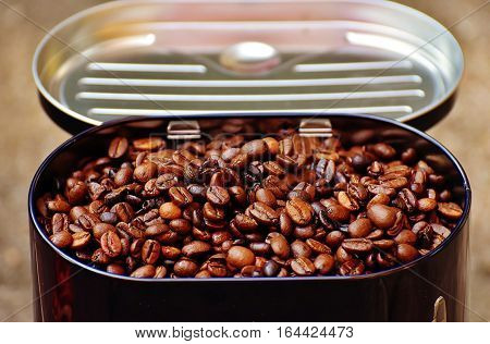 Quality Photo Of Coffee Beans In A Tin Box
