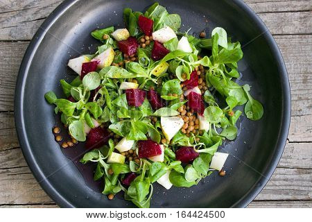 Close Up Of Beet & lettuce Leaf Salad