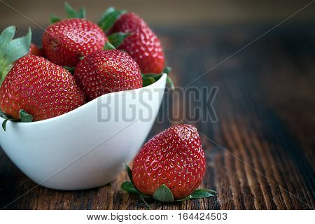 Close Up Of Fresh Strawberries In White Bowl