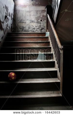 Abandoned stairs with broken glass and a ball