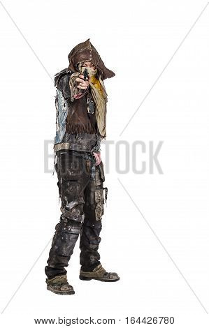 Nuclear post apocalypse life after doomsday concept. Grimy survivor with homemade weapons pointing a gun at the camera. Studio closeup portrait on white background