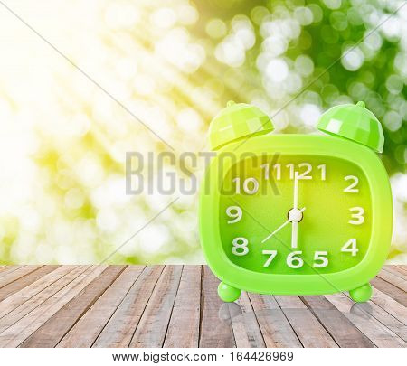 Retro 6 o'clock and Morning sun with Bright and Flare Day Light Blur Green Garden Background with space for text.