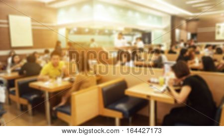 The Blurred background of restaurant with people.