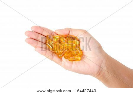 Hand holding fish oil capsules isolated on white background Saved clipping path.