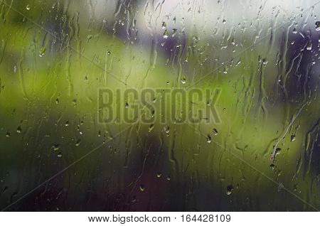 Water drops on window - splattered glass - abstract background