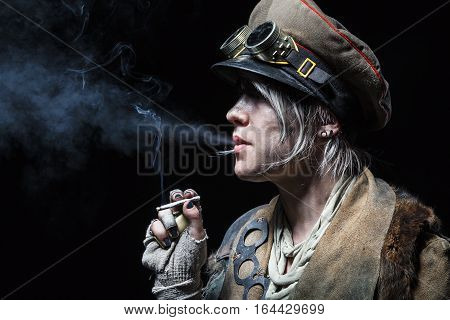 Nuclear post apocalypse life after doomsday concept. Grimy female survivor smoking. Studio closeup portrait on white background