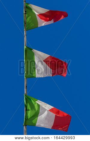 Small Italian flags related to a high-tension wire.