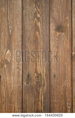 Cracked weathered brown unpainted wooden board texture