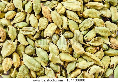 Food background or texture Green cardamon seeds