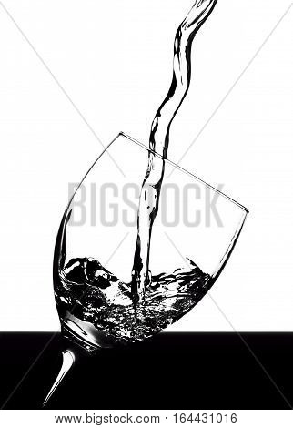 The liquid is poured into a glass of wine on a white background
