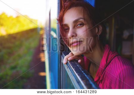 The Girl Looks Out Of The Window Of The Train.