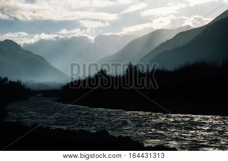 Mountains and Hills with many stacked foggy rainy and smoky ranges highlighted with backlight and sunlight bird eagle flying around view from above poster