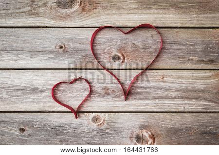 two hearts from ribbon. Valentines Day background