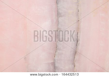 Lightened slices marble onyx. Horizontal image. Warm pink . Beautiful close up background. Ideal for sites, banners, brochures, design