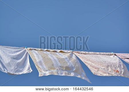 Drying washed laundry in a windy day and clear blue sky