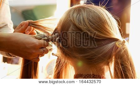 Female model getting her hair dressed before an event. Makeup appearance and hairstyle are important for every beautiful woman.
