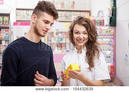 Smiling Doctor And Client In A Pharmacy