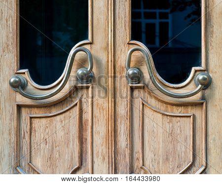 Old wooden entrance door with glass and door handle