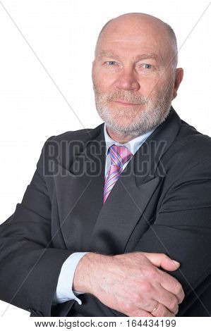 mature businessman posing against white, in formal clothes