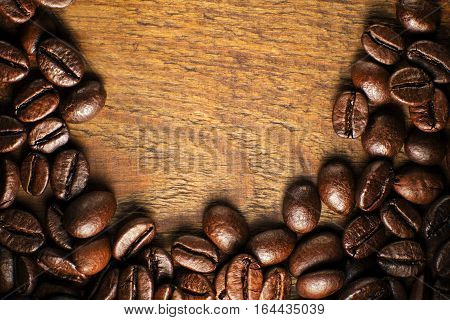 Coffee beans on wooden table close up