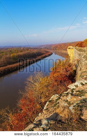 Vertical image of a bluff over looking the Osage River during Autumn. The Osage River is located in the Lake of the Ozarks area of Missouri