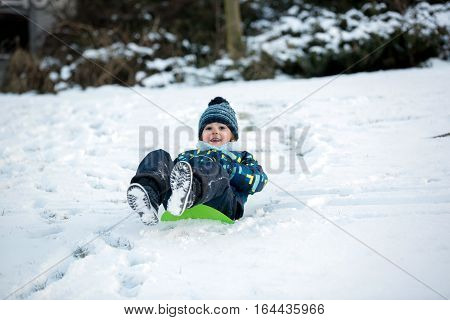 Cute Child, Boy, Sliding With Bob In The Snow, Wintertime