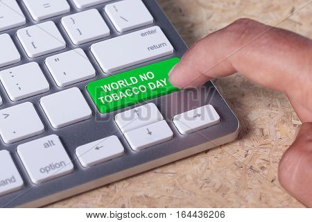Man pressed keyboard button with World No Tobacco Day