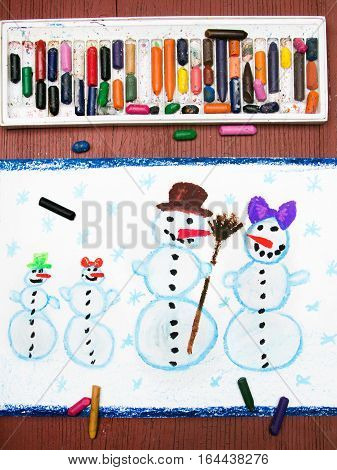 Colorful drawing with crayons of a happy snowman family
