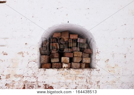 Spaso-Priluckiy monastery in winter. View a gallery of monastery wall. Bricks stacked in a wall niche. Vologda. Travel north Russia. Ancient architecture. Saviour Priluki Monastery