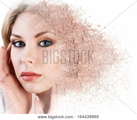 Woman face made from crumbly powder isolated on white background
