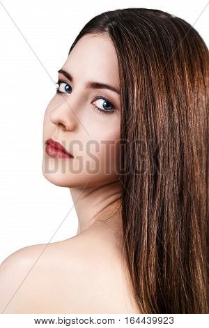 Young beautiful woman with healty fresh skin looking around over white background. Spa concept.