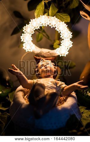 Baby Jesus with a Crown of Lights on the Manger