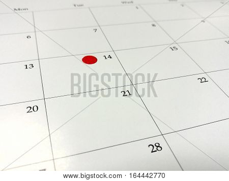 Mark your date on Valentine day on the calendar marker on calendar 14 February love plan close-up