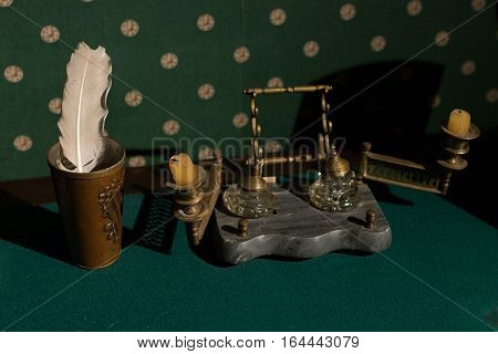 Russian Vintage Accessories For Writing. Old Candlestick On A Table With Green Cloth.