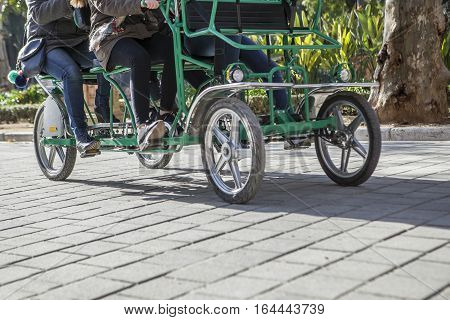 Surrey bikers cycling by Maria Luisa Park Seville Spain