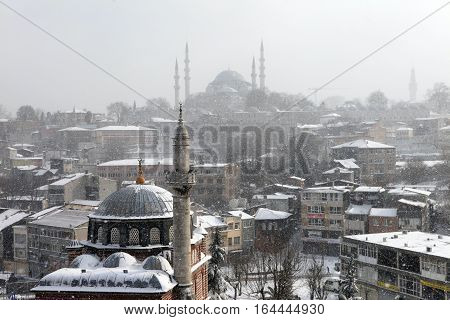 ISTANBUL,TURKEY-JANUARY 8 : istanbul winter a day. Suleymaniye Mosque and Seb Sefa Hatun Camii Unkapan?  while snowing on january 8, 2017 in Istanbul,Turkey.