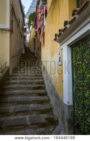 Narrow italian street in Positano town, Italy