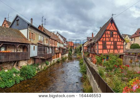 View of Weiss river with historical houses in Kaysersberg Alsace France